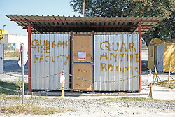 RUSTENBURG SOUTH AFRICA - MAY 18: A quarantine area at a mine shaft near the Seraleng mining community in Rustenburg, South Africa. Seraleng residents gathered at Sibanye k5 mine shaft Communities in the area alleged complaints of food parcel corruption by a local ward councillor. Grievances also included concerns with unemployment, loss of business and access to a social labour plan. (Photo by Gallo Images/Dino Lloyd)