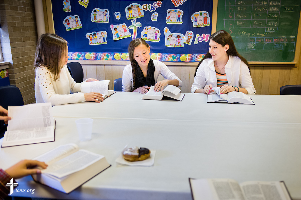 (L-R) Payton Orcutt, Tate Orcutt, and Faith Anderson flip to the correct page during Bible study after worship on Sunday, April 12, 2015, at Mount Calvary Lutheran Church in Holdrege, Neb. LCMS Communications/Erik M. Lunsford