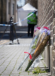 © Licensed to London News Pictures. 05/04/2018. London, UK. Flowers are left in tribute near where a police tent covers a murder scene in Hackney after a 20 year old man was stabbed in Link Street. Police were approached by a man suffering from stab injuries at 8pm last night he was pronounced dead at 8. 24pm by officers. Photo credit: Peter Macdiarmid/LNP
