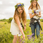 Girls pick flowers for Midsommar wreaths and other decorations by the Borgholm Castle on Öland, a Swedish island in the Baltic Sea. The longest day of the year is a beloved holiday in Sweden; the cities are empty as the locals take to the countryside for a day of dancing and singing with family and friends.