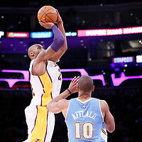 23 November 2014: Los Angeles Lakers guard Kobe Bryant (24) takes a jump shot over Denver Nuggets guard Arron Afflalo (10) during the Los Angeles Lakers season game versus the Denver Nuggets, at the Staples Center, Los Angeles, California, USA.