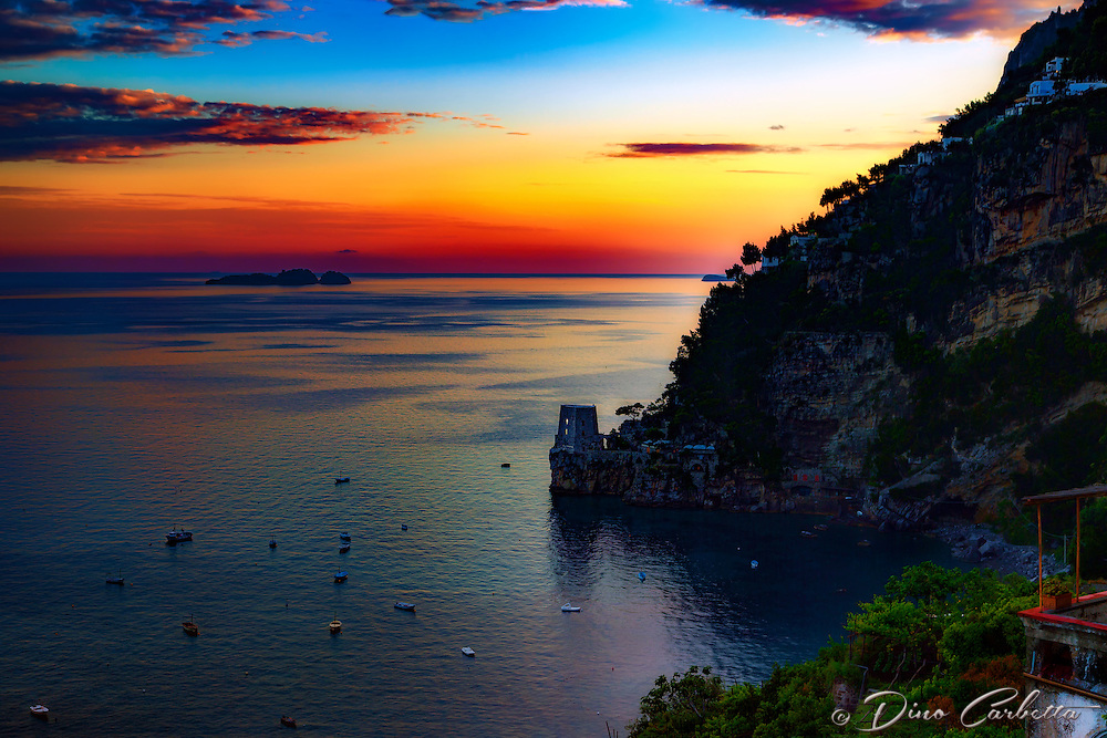 &ldquo;Positano sunset view from Hotel Montemare&rdquo;&hellip;<br /> <br /> The last day of three in Positano was an up and down day of light, dark, rain, cold, and more light.  I began the day with a glorious photo session at sunrise, then took a rainy ferry to Amalfi and was thrilled with the indoor images from the Duomo.  The journey back on the ferry was windy and rainy with an extreme cold front coming in.  I was taken aback at the thought of cold weather in the southern most seaside town of my Italian journey in late May.  However, the waiter who I met the first evening while photographing the sunset, informed me that most of the residents close their shops, restaurants, and hotels during the winter months because of the cold and lack of tourists.  Not having long pants or a heavy coat, dinner at the terrace restaurant of the hotel was frigid, but they had a propane heater and blanket for each diner.  However, with all wet and cold comes the light, and just as the evening came to a close&hellip;.the rain stopped and the sun appeared again&hellip;just in time for a perfect sunset.  Occasionally, one gets lucky and just happens to stay at the perfect location.  The is a view looking north from my hotel up the Amalfi Coast as the sunset ends a very long, but eventful day.