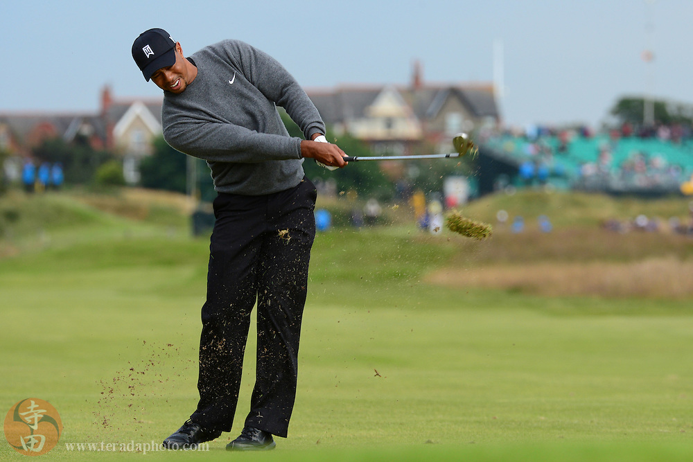 July 20, 2012; St. Annes, ENGLAND; Tiger Woods hits a fairway shot on the 11th hole during the second round of the 2012 British Open Championship at Royal Lytham & St. Annes Golf Club.