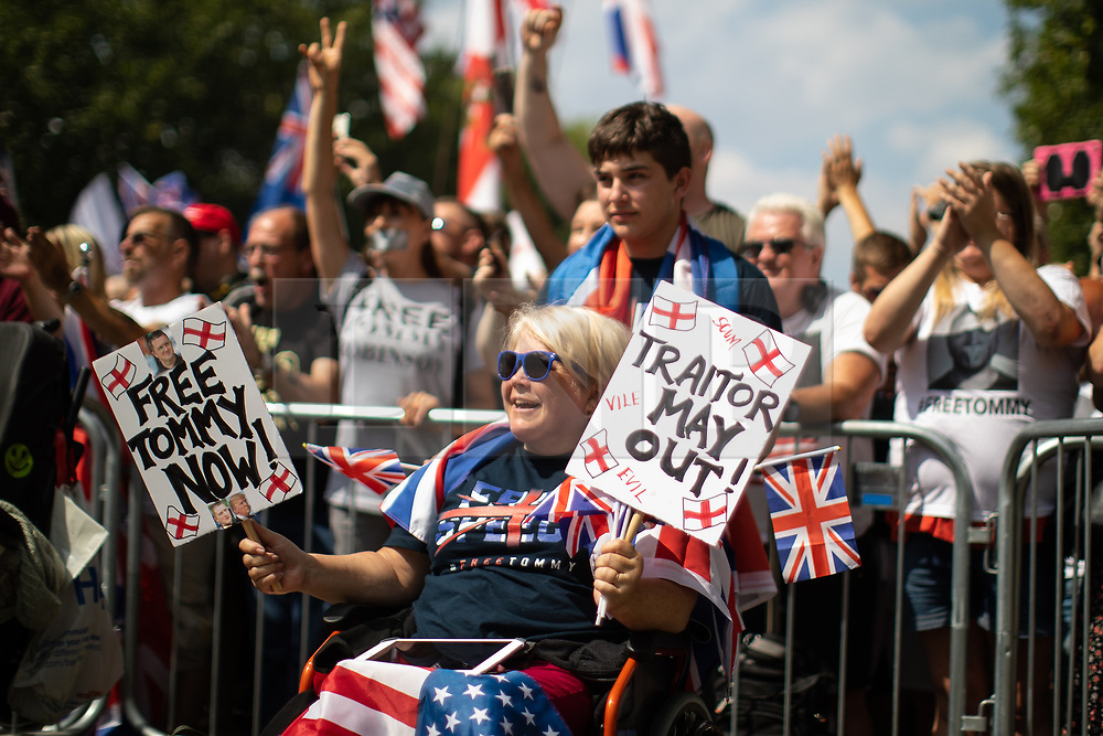"""© Licensed to London News Pictures. 14/07/2018. London, UK. Supporters of EDL founder Tommy Robinson ( real name Stephen Yaxley-Lennon ) and US President Donald Trump hold a """" Welcome Trump """" rally on Whitehall . Trump is currently in Scotland and Robinson is in HMP Hull . Photo credit: Joel Goodman/LNP"""