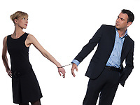 beautiful caucasian couple on studio white background with handcuffs