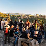 La Alhambra from Mirador de San Nicolas with people in the foreground. Grenada, Spain.