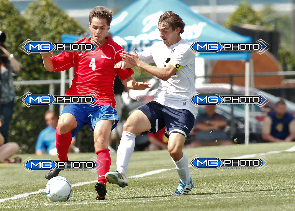 May 10, 2014; Huntsville, AL, USA; Vestavia Nate Dauphin (4) controls the ball from Oak Mountain Keegan McQueen (20) during the Championship game  at John Hunt Soccer Complex. Mandatory Credit: Marvin Gentry