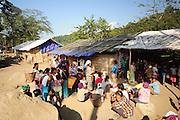 Kachin refugee housewives ai Je Yang Hka near China Myanmar boarder Lai Za. Refugee housewives are waiting for sharing rice.