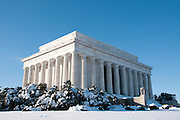 Lincoln Memorial with snow against blue sky