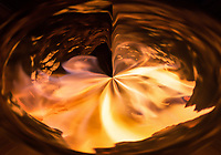 abstract fire vortex in a hole with swirling flames and burning shapes in  red and orange fire light with many shades
