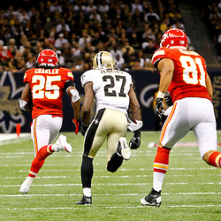September 23, 2012; New Orleans, LA, USA; Kansas City Chiefs running back Jamaal Charles (25) runs for a touchdown as New Orleans Saints safety Malcolm Jenkins (27) chases from behind during the third quarter of a game at the Mercedes-Benz Superdome. The Chiefs defeated the Saints 27-24 in overtime. Mandatory Credit: Derick E. Hingle-US PRESSWIRE