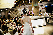 JAKARTA; SUNDAY, NOVEMBER 09, 2014; INDONESIA ECONOMIC RISING: A bride walks during their wedding celebration at a restaurant in a five-star hotel in the business center of Jakarta, Indonesia, on  Sunday, November 9, 2014. According to Asian Development Bank's 2014 report, Indonesia economy growth potential is in creative industry after for years relies heavily on natural resources such as mineral mining and palm oil. By the presidency of Joko Widodo, as a product of the third people election after the People Power Revolution in 1998, Indonesia is more confident in the economy growth and optimistic to become equal in quality to Brazil and China's economy growth. The emerging of Indonesia economy for the last one and a half decade after the end of Suharto's Dictatorship has been in significant way, the per capita growth has reached 400% under Susilo Bambang Yudhoyono presidency. Indonesia is home for 74 million of middle class as estimated by Boston Consulting Group, and  will double in 2020.