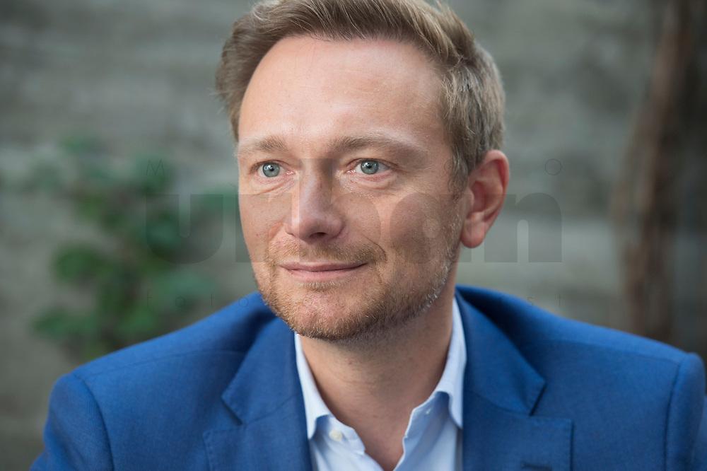 21 AUG 2015, BERLIN/GERMANY:<br /> Christian Lindner, FDP Bundesvorsitzender, waehrend einem Interview, Espresso Bar<br /> IMAGE: 20150821-01-014