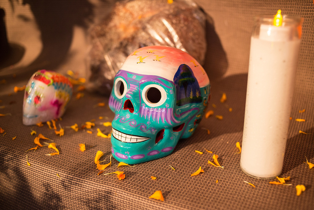 New York, NY, October 31, 2013. Two skulls, or calaveras, surrounded by orange marigold petals, on the public altar.