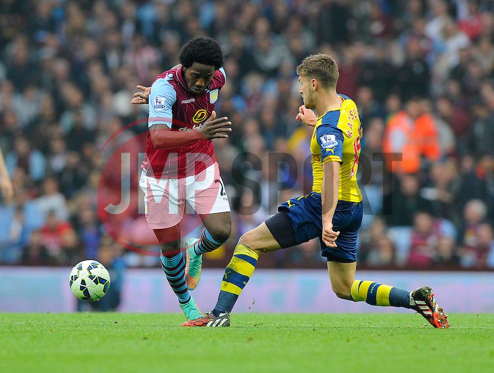 Aston Villa's Carlos Sanchez battles for the ball with Arsenal's Aaron Ramsey  - Photo mandatory by-line: Joe Meredith/JMP - Mobile: 07966 386802 - 20/09/2014 - SPORT - FOOTBALL - Birmingham - Villa Park - Aston Villa v Arsenal - Barclays Premier League