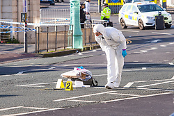 © Licensed to London News Pictures. 01/12/2019. Brighton, UK. A scenes of crime office (SOCO) is looking at items on Marine Parade in Brighton and Hove after 3 men were hit by a car in the aftermath of a mass fight at 5AM on Sunday Morning. 2 people are in hospital with serious head injuries. The police investigation is continuing. Photo credit: Hugo Michiels/LNP