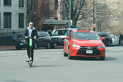 A man on a scooter on a Washington street. From a series of travel photos in the United States. Photo date: Thursday, March 29, 2018. Photo credit should read: Richard Gray/EMPICS