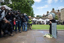 © Licensed to London News Pictures. 09/06/2017. London, UK. Members of the media photograph a campaigner from the organisation Avaaz wearing a Theresa May head as she mourns the 'death of hard Brexit' outside Parliament. Prime Minister Theresa May failed to secure a parliamentary majority in the 8 June 2017 General Election, which she claimed was needed for effective negotiations for Britain's exit from the European Union.  Photo credit: Rob Pinney/LNP