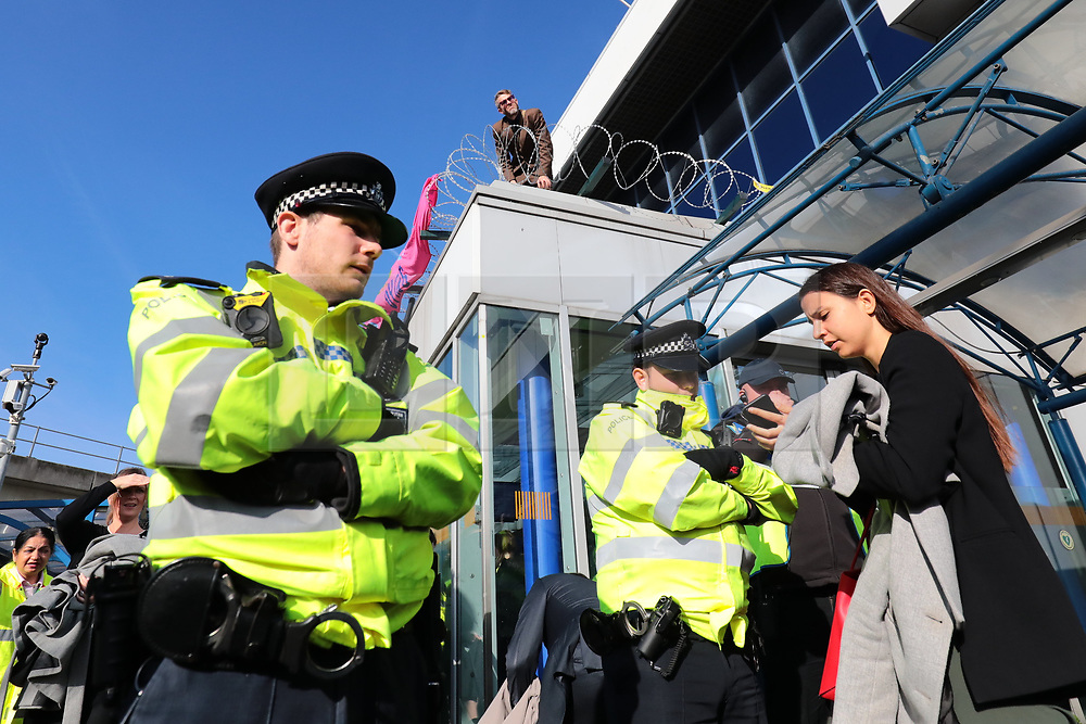 © Licensed to London News Pictures. 10/10/2019. London, UK. Extinction Rebellion protesters at London City Airport. Protesters plan to occupy the terminal building in a 'Hong Kong-style' shutdown as part of ongoing protests calling on government departments to tackle the Climate Emergency. Photo credit: Rob Pinney/LNP