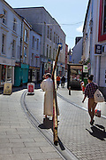 One cross only: An Anglican,  Church of Ireland, priest, the Rev Arthur Minion, carries a bloody crucifix - in his bare feet - along Wexford's Main Street, Good Friday, 2014. (c) Dave Walsh 2014
