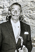 photo of a life sized black and white print of Salvador Dali against a white wall