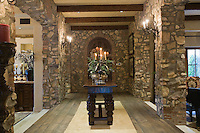 Exposed stone entrance hallway of Palm Springs home