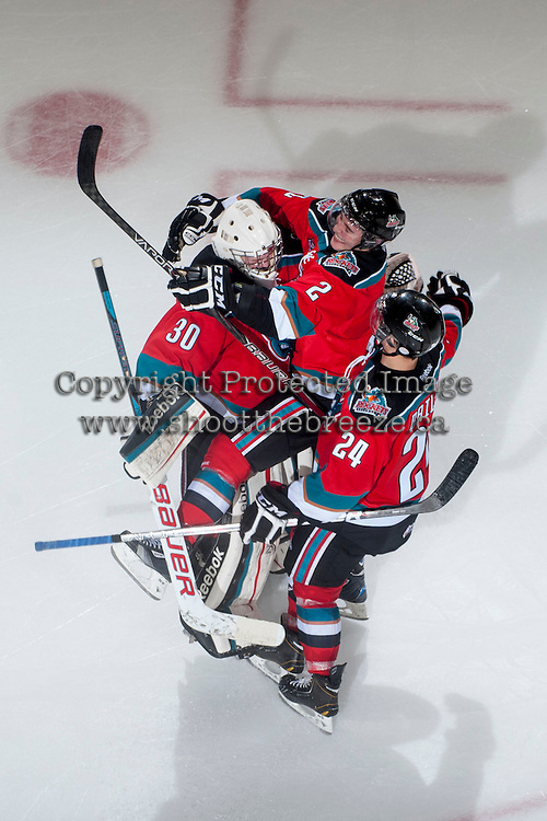 KELOWNA, CANADA - NOVEMBER 1:  Jordon Cooke #30 is congratulated on a shut out by teammates Jesse Lees #2, and Tyson Baillie #24 of the Kelowna Rockets as the Kamloops Blazers visit the Kelowna Rockets on November 1, 2012 at Prospera Place in Kelowna, British Columbia, Canada (Photo by Marissa Baecker/Shoot the Breeze) *** Local Caption ***