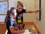 Volunteer mentor Dorothy Hogg (from right), 15, points out the name of a painter to McKenzie Clark, 8, both of Cedar Rapids, as she works on a scavenger hunt during the Summer Reading Camp at Coe College in Cedar Rapids on Wednesday, August 1, 2012. Twenty students participated in the week long camp which is sponsored by Christ Episcopal Church. This is the seventh year of the camp and there is no fee for the students. The main goal of the camp is to teach students that reading is fundamental and can be fun. Organizers also want to give students the opportunity to see a college campus. The daily activities include reading time, word games, group games, swimming, and soccer.