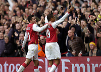 Photo: Olly Greenwood.<br />Arsenal v Tottenham Hotspur. The Barclays Premiership. 02/12/2006. Arsenal's Gilberto celebrates scoring from the penalty spot with Robin Van Persie