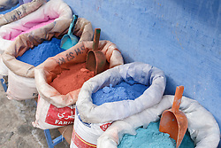 Colorful pigments for sale in marketplace, Chefchaouen, Morocco