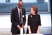 UNITED KINGDOM, London: 26 January 2016 Rwandan genocide survivor Jean Baptiste Kayigamba (left) and Holocaust survivor Hannah Lewis (right) light a memorial candle in City Hall at the end of a memorial service to remember victims of the Holocaust this morning. The Mayor of London, Boris Johnson, joined members of the London Assembly as well as Holocaust survivors to mark 71 years since the liberation of Auschwitz-Birkenau and to pay tribute to victims of other subsequent genocides. Rick Findler / Story Picture Agency