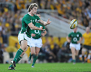 Andrew Trimble passes to support out wide for Ireland during action from the Rugby Union Test Match played between Australia and Ireland at Suncorp Stadium (Brisbane) on Saturday 26th June 2010 ~ Australia (22) defeated Ireland (15) ~ © Image Aura Images.com.au ~ Conditions of Use: This image is intended for Editorial use as news and commentry in print, electronic and online media ~ Required Image Credit : Steven Hight (AURA Images)For any alternative use please contact AURA Images