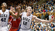 21 November 2009: Duke Junior Forward #12 Kyle Singler and Duke Senior Forward #42 Lance Thomas block out Radford (33) Jamal Curry freshman forward..Duke Rolls Past Radford 104-67 .Mandatory Credit: Mark Abbott / Southcreek Global