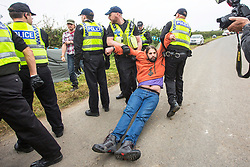 © Licensed to London News Pictures. 20/09/2017. Kirby Misperton UK. A man is removed by police from the entrance of the Kirby Misperton KM8 fracking site this morning as a second day of protests have started. It is thought that equipment to erect noise barriers is being bought in. Third Energy was granted planning permission last year to frack the site but has not yet received final consent to begin fracking, but expects to start before the end of the year. are Photo credit: Andrew McCaren/LNP