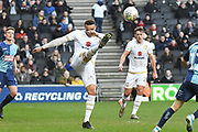 Milton Keynes Dons forward (on loan from Norwich) Carlton Morris (23) clears the ball during the EFL Sky Bet League 1 match between Milton Keynes Dons and Wycombe Wanderers at stadium:mk, Milton Keynes, England on 1 February 2020.