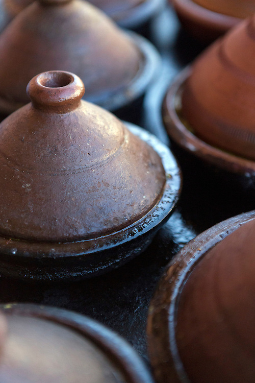 Ceramic tagines slow cook at roadside street food stall, Bab Doukkala, Marrakech, Morocco, 2018–03-31.