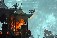 China, Wutai Shan, 2008. Consumed by flames, offerings from Buddhist visitors on a holy day fill the winter air in front of Tayuan Temple, centrally located in Taihuai town.
