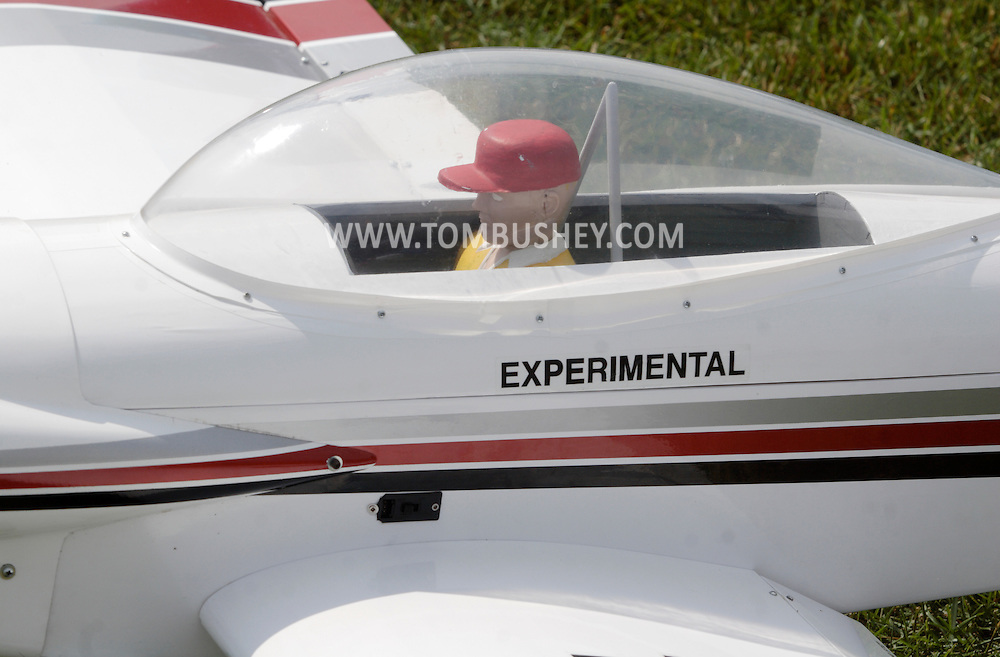 New Hampton, New York - A plastic pilot sits in the cockpit of a remote controlled airplane at a fly-in sponsored by the Wawayanda Flying Club on June 5, 2010.