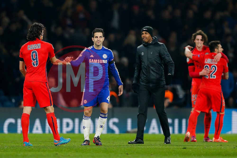 Cesc Fabregas of Chelsea looks dejected as he congrtulates Edinson Cavani of Paris Saint-Germain after the match ended 2-2 (3-3) sending PSG through to the Quarter Finals on away goals - Photo mandatory by-line: Rogan Thomson/JMP - 07966 386802 - 11/03/2015 - SPORT - FOOTBALL - London, England - Stamford Bridge - Chelsea v Paris Saint-Germain - UEFA Champions League Round of 16 Second Leg.