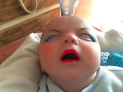 """Mum Tries out Makeup App on her 7 week old son with very funny results <br /> <br /> You probably shouldn't put make-up on a baby, but let's face it – given the opportunity, we'd all be curious to see what a baby would look like with heavy makeup. Using a makeup app, one mum did just that. These photos of her 7-week-old baby covered in make-believe makeup and wigs are both disturbing and hilarious.<br /> <br /> Putting real makeup on a baby is a no-no - so it's only thanks to the wonders of modern technology that we can see what a newborn looks like in full lippy, eye makeup and blusher.<br /> <br /> A new mum used the YouCam Makeup - Makeover Studio app on her phone to give her 7-week-old son a variety of dramatic virtual makeovers.<br /> <br /> She said: """"I intentionally take/use photos of him pulling faces and gurning because I live to amuse myself.""""<br /> ©Exclusivepix Media"""