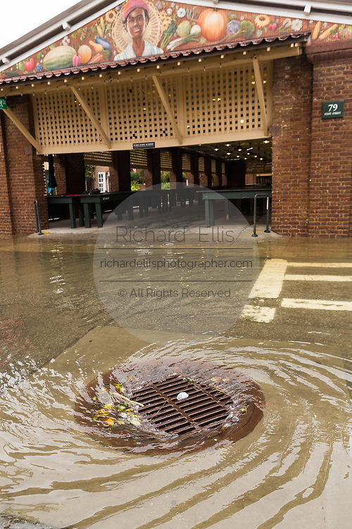 A storm drain draws floodwater from the historic City Market as Hurricane Joaquin brings heavy rain, flooding and strong winds as it passes offshore October 4, 2015 in Charleston, South Carolina.