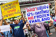 27 MAY 2014 - BANGKOK, THAILAND: Several hundred people protested against the coup in Bangkok at Victory Monument Tuesday. It was the fourth straight day of pro-democracy rallies in the Thai capital as the army continued to tighten its grip on Thai life. The protest Tuesday was the smallest so far.     PHOTO BY JACK KURTZ