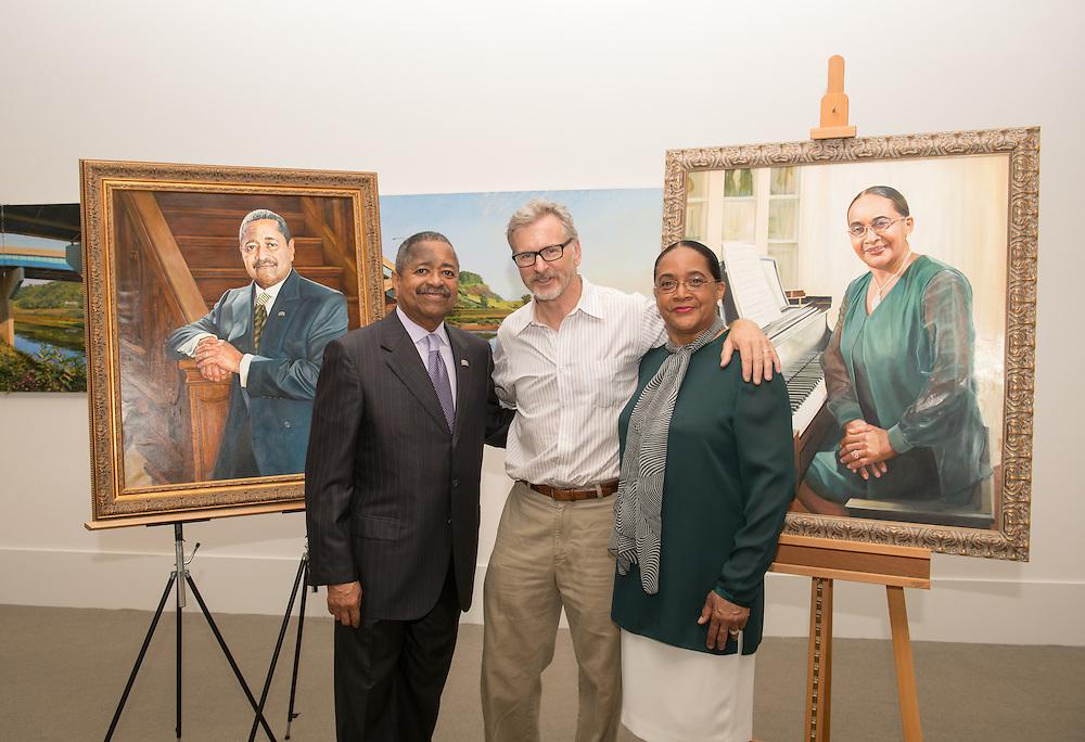 President Roderick McDavis (Left) and First Lady Deborah McDavis stand with portrait artist Rob Hartshorn in the Kennedy Museum. Photo by Ben Siegel/ Ohio University