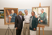 President Roderick McDavis (Left) and First Lady Deborah McDavis stand with portrait artist Rob Hartshorn in the Kennedy Museum. Photo by Ben Siegel/ Ohio University