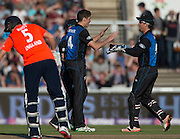 Mitchell Santner, bowling in his first international t20, celebrates bowling Jonny Bairstow for 1 during the t20 international, England v New Zealand at Old Trafford, Manchester. Photo: Graham Morris/www.photosport.nz