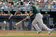 PEORIA, AZ - MARCH 05:  Ryon Healy #25 of the Oakland Athletics hits an RBI double in the second inning against the Seattle Mariners during the spring training game at Peoria Stadium on March 5, 2017 in Peoria, Arizona.  (Photo by Jennifer Stewart/Getty Images)