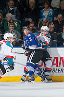 KELOWNA, CANADA - MARCH 11: Ryan Gagnon #3 of Victoria Royals checks Nick Merkley #10 of Kelowna Rockets at the boards on March 11, 2015 at Prospera Place in Kelowna, British Columbia, Canada.  (Photo by Marissa Baecker/Shoot the Breeze)  *** Local Caption *** Ryan Gagnon; Nick Merkley;