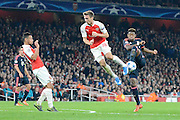 Bayern Munich defender David Alaba shot is blocked by Arsenal defender Nacho Monreal during the Champions League  Group F match between Arsenal and Bayern Munich at the Emirates Stadium, London, England on 20 October 2015. Photo by Alan Franklin.