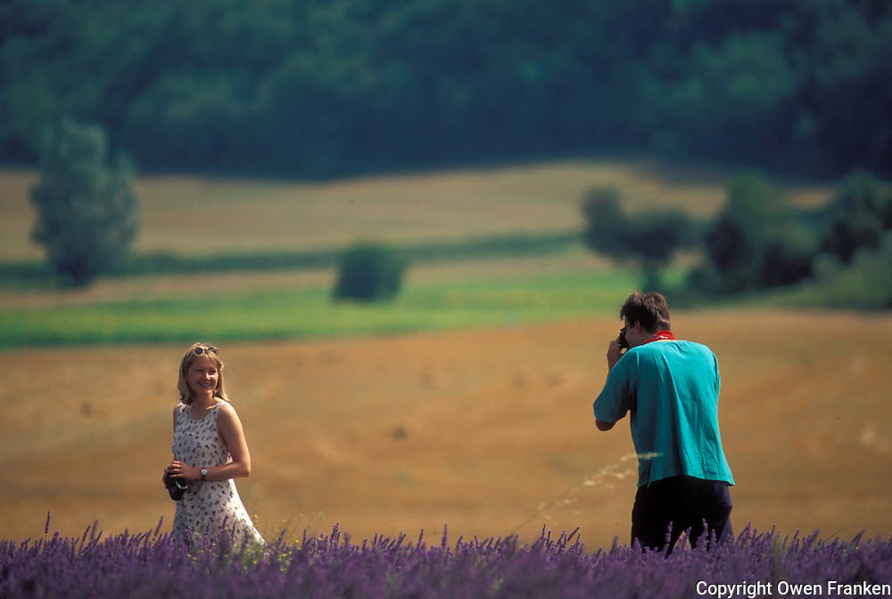 couple photographing in a field of lavender, Provence - photograph by Owen Franken
