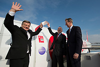 20 MAR 2012, BERLIN/GERMANY:<br /> Willie Walsh, CEO International Airlines Group, IAG, Thomas W. Horton, AMR Corporation und American Airlines Chairman und Chief Executive Officer, (v.L.n.R.), Enthuellung eines ineworld-Logos an einem Air Berlin Flugzeug, anlaesslich der Beitrittserklaerung von Air Berlin zum weltweiten Luftfahrtbuendnis oneworld, Flughafen Berlin Brandenburg<br /> IMAGE: 20120320-01-207